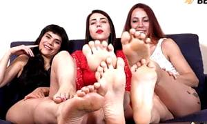 Three girls spreading her toes and showing feet